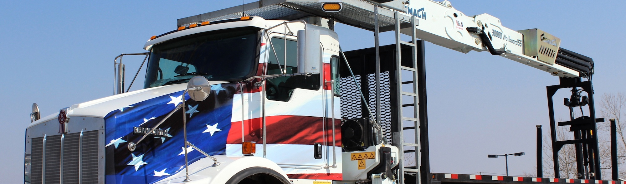 Cormach drywall boom truck with American flag wrap