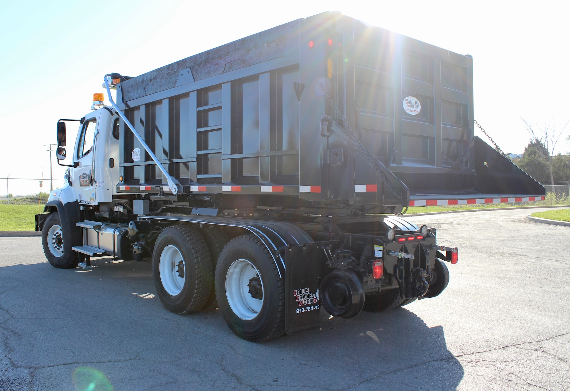 Roto dump truck with hi-rail package
