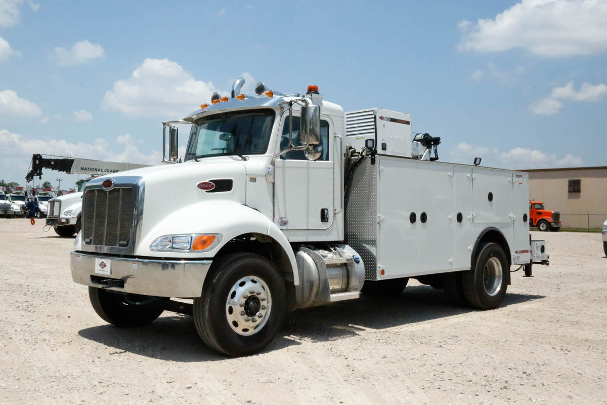 IMT 12000 with Dominator III service body 0