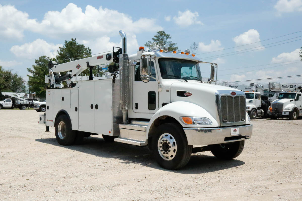 IMT 12000 with Dominator III service body 1