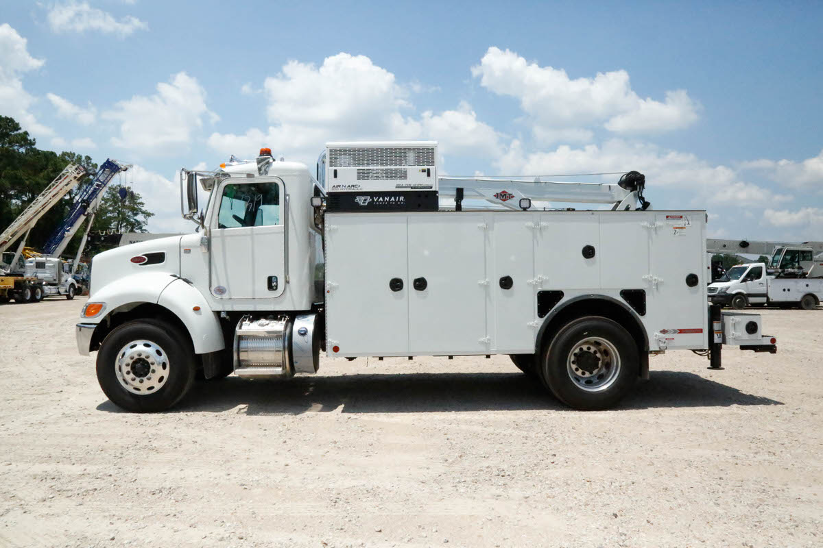 IMT 12000 with Dominator III service body 3